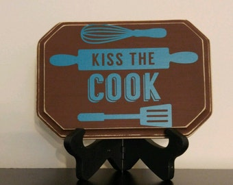 Home decor, vinyl, wall hanging, wood sign, kiss the cook, kitchen, utensils
