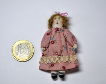 Mini fabric doll