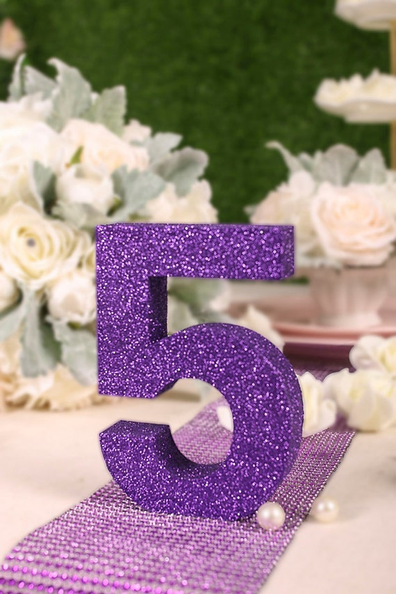 Christmas new year 39 s eve party annual dinner party table for Glitter numbers for centerpieces