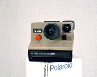 Polaroid 500 / vintage camera with original packaging 70s