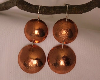 Copper disks with sterling silver ear wires.