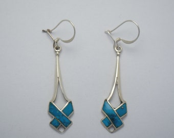 Dangling turquoise earrings and sterling silver