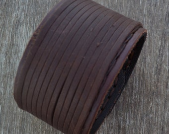 brown leather bracelet with stripes