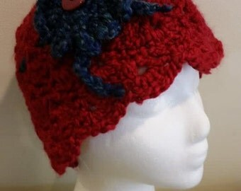 Crocheted child's dark red Hat with blue flower