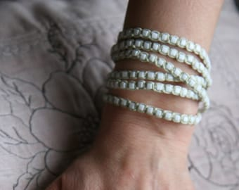 Pistachio multi-strand beaded bracelet, braided with waxed cord and glass Japanese Toho seed beads