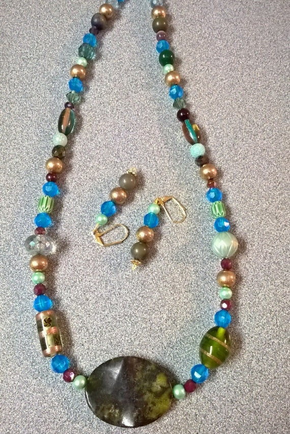green and blue beaded necklace with pendant