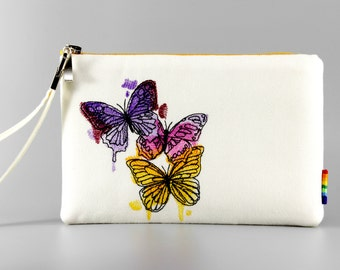 Embroidered Clutch with strap.