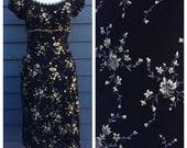 Vintage 1990's Betsey Johnson dress . Black and gold floral . Metallic trim.