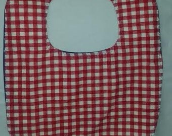 Red checked child bib with blue stars