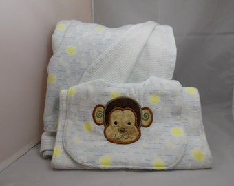 Handcrafted matching bib, burp cloth, and receiving blanket