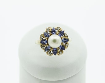 A Tanzanite , pearl and Diamond Statement Ring