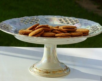 Vintage cake stand. French cake stand in iridescent pierced porcelain.