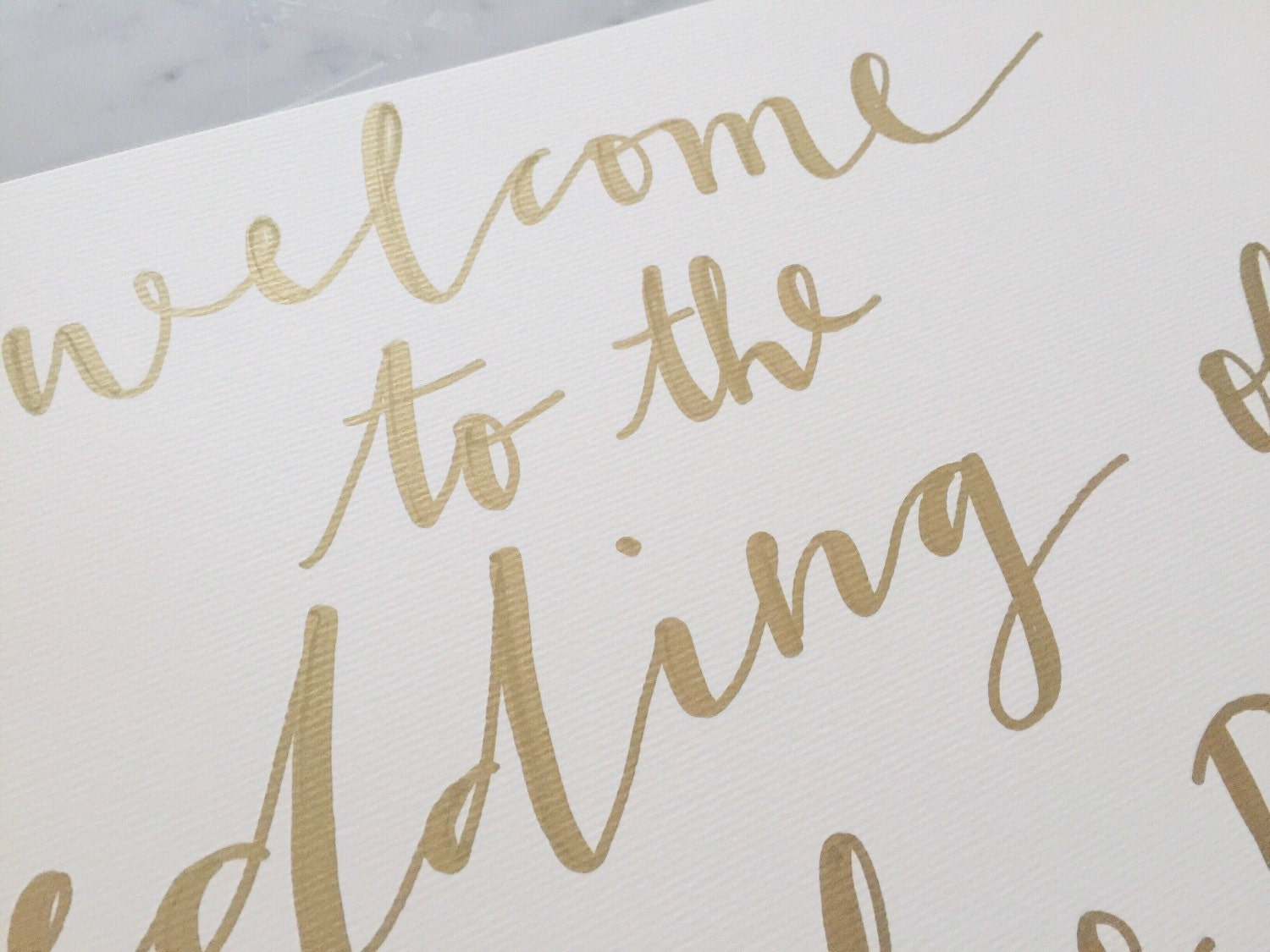 Custom a hand drawn metallic gold lettering sign