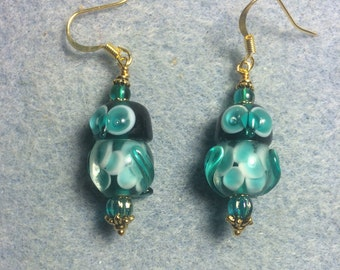 Teal lampwork owl bead dangle earrings adorned with teal Czech glass beads.