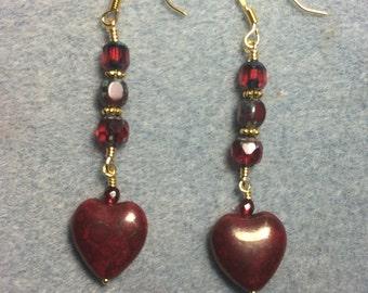 Blood red Czech glass heart bead dangle earrings adorned with dark red Czech glass beads.