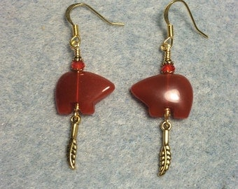 Carnelian gemstone Zuni bear fetish bead earrings adorned with tiny gold feather charms and red  crystal beads.