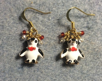 Black, white and red enamel penguin charm earrings adorned with tiny dangling black, clear and red Chinese crystal beads.