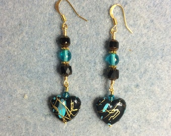 Turquoise, black and gold acrylic heart bead dangle earrings adorned with turquoise and black Czech glass beads.