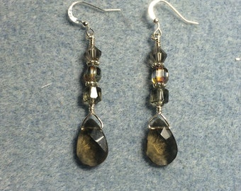 Smoke gray briolette dangle earrings adorned with smoke gray Czech glass beads.