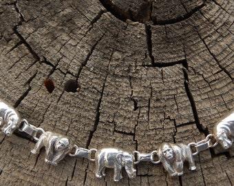"""CAROL FELLEY elephant bracelet sterling link southwestern 1981 signed endangered species, gorilla, elephant, hippo dimensional link 6.75 """"."""