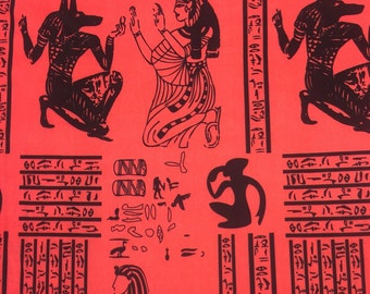 100% polyester. 60 inch. Deep coral Egyptian inspired print in black. Fabric by the yard