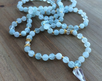 108 bead Mala made from Aquamarine, Herkimer Diamonds, 24k Gold vermeil, and a Crystal Quartz Guru stone. -Yoga Jewelry