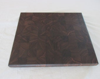 Cutting board made of solid end grain walnut wood. Great Christmas or birthday gift for anyone who loves to cook.