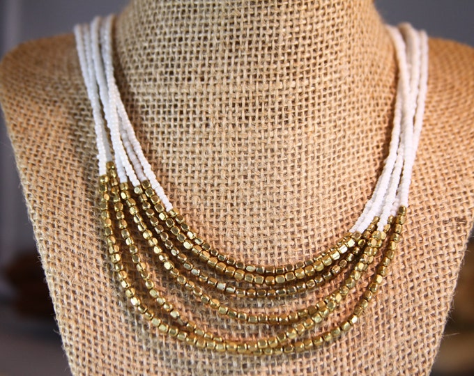 Multi strand white & Gold necklace