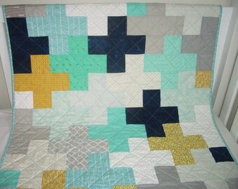 Modern baby quilt, navy grey aqua theme, cross quilt.