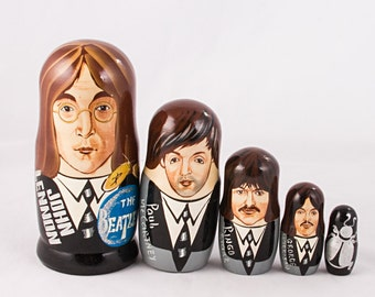 The Beatles Nesting Dolls. John Lennon, Paul McCartney, Ringo Starr, George Harrison, and a beetle.