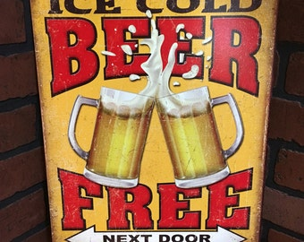 Free Beer Next Door tin sign
