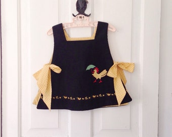 1960s black corduroy apron top with a rooster appliqué / rooster with an umbrella / rooster top / 4T