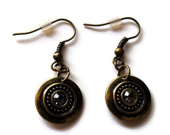 Handmade dangle earrings antiqued effect bronze shield with a clear crystal inset