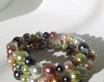 Green, pink,white, orange and black wrap bracelet