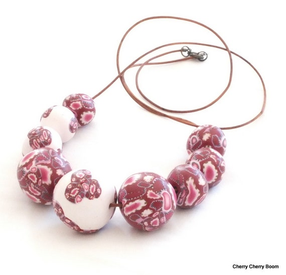 Chunky polymer clay necklace of handmade beads on brown leather cord - in Boho Summer