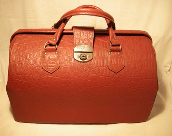 Vintage 1970's Red Leather Travel Bag. Brand: CHENEY
