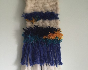 blue, yellow wall hanging