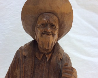 Handcarved butternut wood statue by  Quebec artist P E Caron.