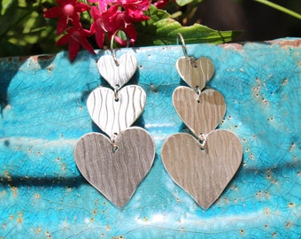 Three Sterling Silver Heart Earrings Cascading Down With Lots of Movement