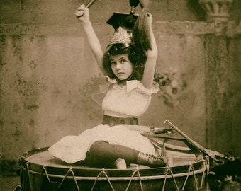 Vintage photo antique photograph child children circus performer girl on drum 1900s sepia photography PRINT