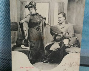 Beautiful black and white antique French postcard. Railway train theme seduction man and woman 1903