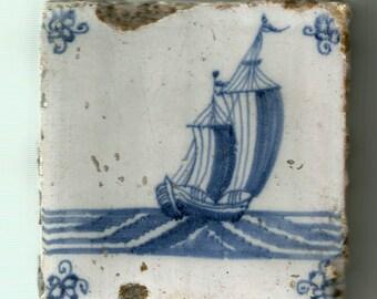 Antique Delft tile Dutch Blue and White . Dutch boat in Delft blue and white .