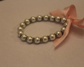 Pearl ribbon bracelet with silver spacers