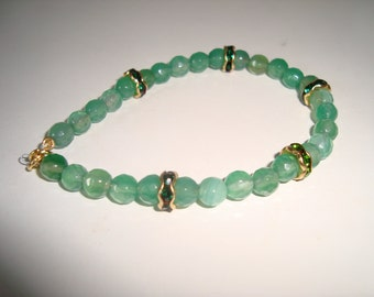bracelets ca 20 cm green onyx with rhinestones in between. Filled gold lock and eye
