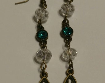 Turquoise, crystal, and spike earrings.