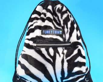 Drawstring Backpack in Zebra Faux-Fur with Zipped Pocket