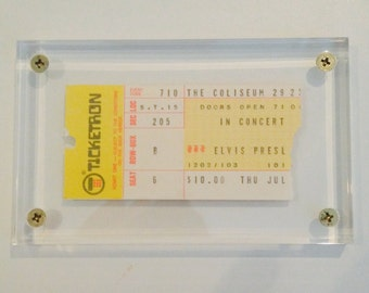 In acrylic holder 1975 Authentic Elvis Presley Concert ticket stub with certificate.