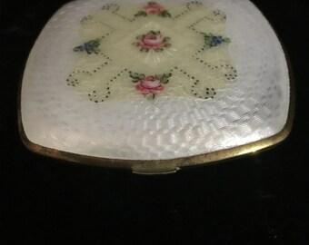 White enamel guilloche compact by   La Mode