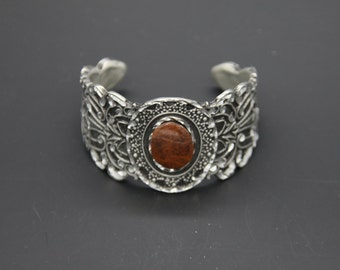 Bracelet with reddish/ Brown Stone
