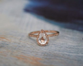 White topaz, rose gold, diamond accented, pear shaped ring